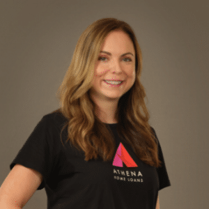 A headshot photo of a woman smiling wearing an Athena branded T-shirt